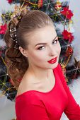 beautiful sexy happy smiling young woman in evening dress with bright makeup with red lipstick