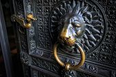 Lions Head Doorknob On An Old Church Door