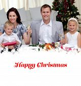 Parents toasting with champagne in Christmas dinner against happy christmas