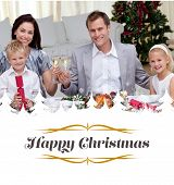Parents toasting with wine in Christmas dinner against border