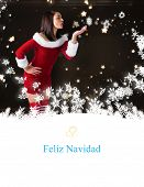 pretty girl in santa outfit blowing against tree spiral