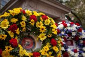 NEW YORK - NOV 11, 2014: A US Marine Corps floral wreath of gold and scarlet placed by the Eternal Light Flagstaff monument in Madison Square Park on Veterans Day in Manhattan on Nov 11, 2014.