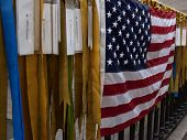 NEW YORK - NOV 11, 2014: Ribbons and the American Flag on an iron fence symbolize prayers for lives lost in the Iraq and Afghanistan wars at Marble Collegiate Church in Manhattan on Veterans Day 2014.