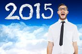 Geeky young businessman shouting loudly against bright blue sky over clouds
