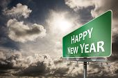 Happy new year against dark sky with white clouds
