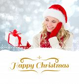 happy festive blonde with gift against border