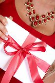 Hands of young woman with Christmas gift