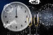 Clock at midnight against champagne