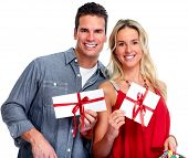 Couple with  envelope Christmas gift isolated white background.