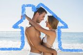 Sexy couple embracing against house outline