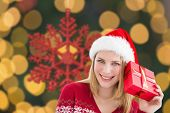 Woman checking her present against red christmas snowflake decoration hanging