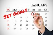 picture of composition  - Composite image of new years resolutions on january calendar - JPG