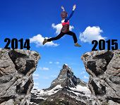 Girl jumps to the New Year 2015 in the background mount Matterhorn