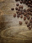 coffee beans closeup on old wooden table