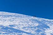 Ski Alpinist In Alpine Winter Scene