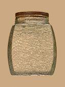 Golden Glass Jar On Beige Background.