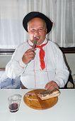 Man Wearing Traditional Clothing Enjoying A Meal
