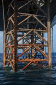 Underneath Jack Up Drilling Rig In The Ocean - Oil And Gas Industry