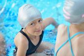 happy little child portrait on swimming school classes and recreation at indoor pool