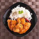 chicken cooked with curry and rice