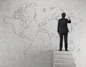 Businessman Drawing World Map