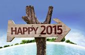 Happy 2015 sign with a beach on background