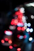 Abstract Circular Bokeh Background Of Red Lights In Black Background
