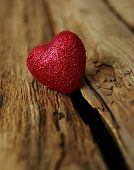 Red heart on a wood background