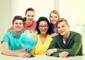 education, travel and geography concept - five smiling student with earth globe at school