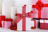 Christmas presents with candles on white background