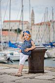 cute little girl on the walk in marina in piran, slovenia