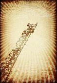 Grunge Transmitter Tower Against Sunburst Image.
