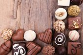 Group of sweets on wooden textured background