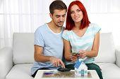 Loving couple save money on house