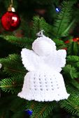 foto of christmas angel  - Knitted Christmas angels and other decorations on Christmas tree background - JPG