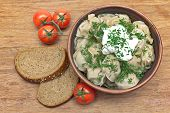 Dumplings With Fresh Herbs And Sour Cream In A Dish, Cherry Tomatoes And Bread
