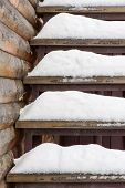 Powdery Snow Covered Old Wooden Stairs.
