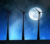 Wind turbines under a full moon