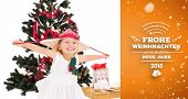 Festive little girl smiling at camera against orange vignette