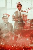 Confident businessmen wearing novelty Christmas hat against glittering christmas tree design