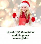 happy festive blonde with shopping bag against christmas greeting in german