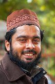 Closeup Of Smiling Young Muslim Man In Delhi.