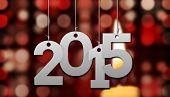 2015 against candle burning against festive background