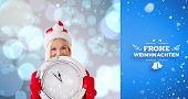 happy festive blonde with clock against blue vignette