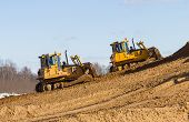 Two Bulldozer At Work In Forest