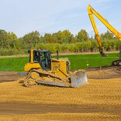 Yellow Excavator At Work
