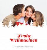 Father and his daughter offering a red gift against christmas greeting in german