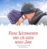 mature winter couple against frohe weihnachten message