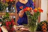 Female florist working in design studio