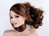 foto of brown-haired  - Sensuality and attractive young woman face with beauty hairs - JPG